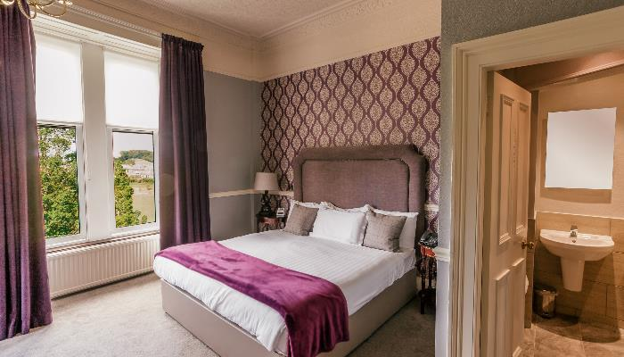 Signature room 216 offers beautiful views of Braidburn Valley Park and The Pentland Hills