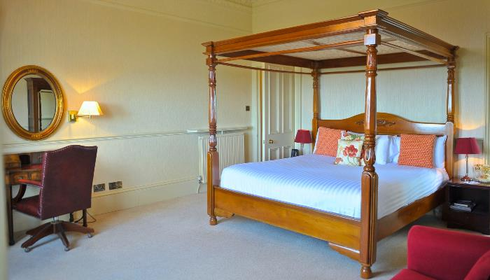 Spacious four poster bedrooms with city views